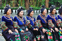 The chinese miao old women. With traditional clothes were singing for tourists in Miao Ethnic Minority Village ( or Villages of Thousands of Miao House-holds) stock photography