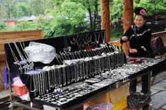 Chinese miao woman sell Silver ornaments Royalty Free Stock Images