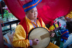 Chinese mid adult man playing musical instrument Royalty Free Stock Photography