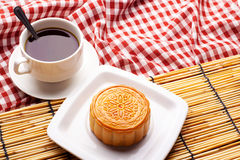 Chinese mid autumn festival foods. Traditional moon cakes on table setting with teacup stock images