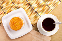 Chinese mid autumn festival foods. Traditional moon cakes on table setting with teacup stock image