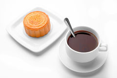 Chinese mid autumn festival foods. Traditional mooncakes. On white table setting with teacup. on white background royalty free stock photo