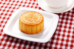 Chinese mid autumn moon cake festival foods. Traditional Chinese dessert on table setting with teacup royalty free stock photos