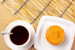 Chinese mid autumn moon cake festival foods. Chinese mid autumn festival foods. Traditional mooncakes on table setting with teacup royalty free stock image