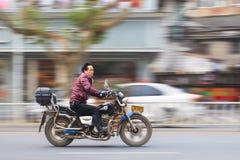 Chinese middel aged man ona motorcycle, Yiwu, China Royalty Free Stock Photos