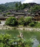 Chinese Minority Village. Ethnic Chinese Miao village near a river in rural China Royalty Free Stock Photos