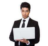 Chinese mixed Indian businessman use of the laptop computer Royalty Free Stock Photography