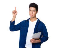 Chinese mixed iranian man hold with tablet and finger point up Stock Photos