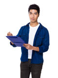 Chinese mixed iranian man write on the file board Royalty Free Stock Images