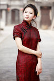 Chinese model in cheongsam. Traditional Chinese woman in cheongsam standing in the ancient  alley Stock Images
