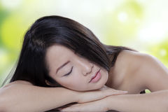Chinese model relaxing after skin treatment Stock Photos