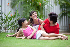 Chinese mom having fun with her daughters. In the garden royalty free stock photography