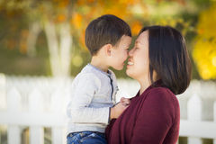 Chinese Mom Kissing Her Mixed Race Son Royalty Free Stock Photos