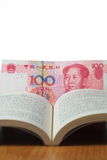 Chinese money in a book Royalty Free Stock Image