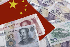 Chinese Money and a flag. Chinese banknotes with a Chinese flag in the top left side Royalty Free Stock Images
