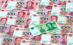 Chinese Money One Yuan. Chinese money, banknote one yuan on the background of one hundred yuan banknotes royalty free stock photography