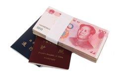 Chinese money and passport Stock Photography