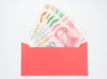 Chinese money. In red envelope stock images