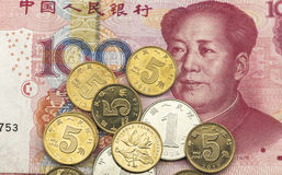 Chinese money. Chinese renminbi 100 yuan bank note and coins Royalty Free Stock Photography