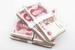 Chinese Money (RMB). Chinese 100 RMB banknotes Stacked on a white background Royalty Free Stock Photos