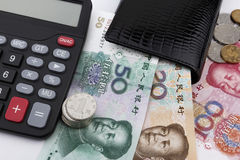 Chinese money (RMB),  and a calculator. Business concept. Chinese money (RMB),  a calculator and a black wallet. Business concept Royalty Free Stock Photos