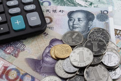 Chinese money (RMB) and a calculator. Royalty Free Stock Images