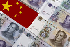 Chinese Money (RMB) And Flag. Chinese banknotes lined up with a Chinese flag in the top left corner Stock Image