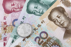 Chinese money (RMB). 20, 50 and 100 RMB note, with a 1 RMB coin on top Royalty Free Stock Images