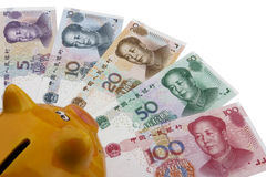 Chinese money (RMB). Chinese money (RMB) and a piggy bank on a white background. Business concept Stock Photos