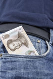 Chinese money (RMB) in a pocket. Chinese money (RMB) in the front pocket of a pair of blue jeans. (20 RMB note Royalty Free Stock Images