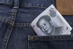 Chinese money (RMB) 10 RMB note. In a pocket of a pair of blue jeans Royalty Free Stock Image