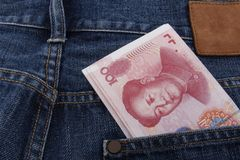 Chinese money (RMB) 100 RMB note. In a pocket of a pair of blue jeans Stock Photography