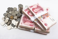 Chinese money (RMB). Stacked Chinese 100 notes with coins in the left side Stock Image