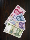 Chinese money, RMB. Chinese money, yuan, lie a fan on a dark background Stock Photo