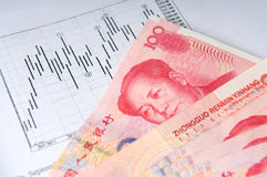 Chinese money with stock chart Stock Image