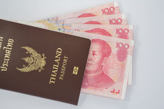 Chinese money. With Thailand Passport royalty free stock photography