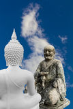 Chinese monks and Buddha statues discussion. Royalty Free Stock Photo