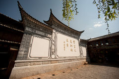 Chinese monument wall in Lijiang Dayan old town. Royalty Free Stock Photos