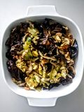 Chinese Moo Shu Pork. In its traditional Chinese version, moo shu pork consists of sliced pork tenderloin, cucumber, and scrambled eggs, stir fried in sesame or Royalty Free Stock Photos