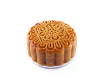 Close-up single Chinese Moon Cake isolated on white background, traditional food or snack made from flour and stuffed with cereals. Traditional food or snack stock photo
