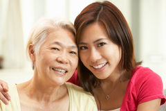 Chinese Mother With Adult Daughter At Home Stock Image