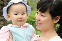 Chinese mother and baby Royalty Free Stock Image