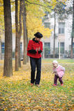 Chinese mother and baby in autumn Stock Image