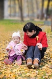Chinese mother and baby in autumn Stock Photos