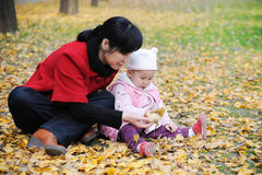 Chinese mother and baby in autumn Royalty Free Stock Images