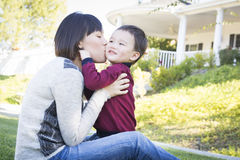 Chinese Mother Having Fun with Her Mixed Race Baby Son Stock Photo