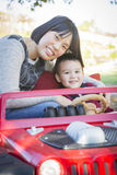 Chinese Mother Having Fun with Her Mixed Race Baby Son Stock Image