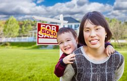 Chinese Mother and Mixed Race Child In Front of Custom House and Royalty Free Stock Images