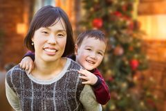 Chinese Mother and Mixed Race Child Inside House In Front of Dec Stock Photo