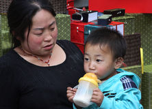 Chinese mother and son. A mother with son in Beijing, China. In China, the One-child policy introduced in 1978, allows only one child for family. The Chinese stock photo